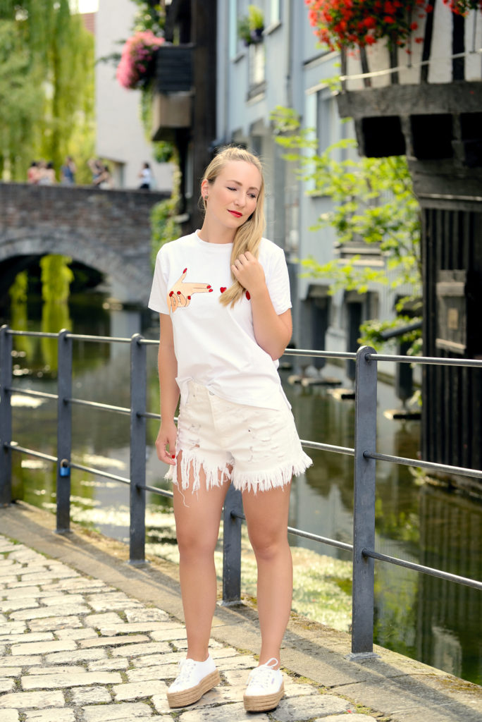 All-White Look with a Statement T-Shirt & Supergas in Ulm